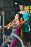 Gym woman and her trainer doing exercise at the gym Royalty Free Stock Photography