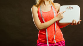 Gym woman holding weight scale Royalty Free Stock Photography