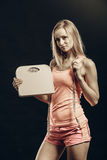 Gym woman holding weight scale Royalty Free Stock Images