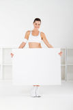 Gym woman holding whiteboard Royalty Free Stock Image