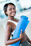 Gym woman holding yoga mat Stock Image