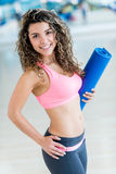 Gym woman holding yoga mat Royalty Free Stock Photo
