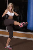 Gym woman kick Stock Photos