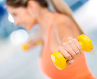 Gym woman lifting weights Royalty Free Stock Image