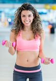 Gym woman lifting weights Royalty Free Stock Photography