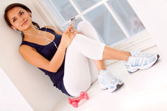 Gym woman listening to music Stock Photography