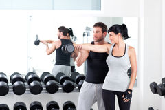 Gym woman personal trainer with weight training. Gym women personal trainer men with weight training equipment Stock Image