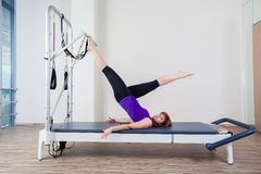 Gym woman pilate instructor stretching in reformer Stock Photography