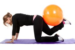 Gym woman with pilates ball Royalty Free Stock Image