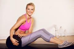 Gym Woman with a Pilates Ball Stock Photos
