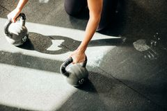 Woman push-up strength pushup exercise on kettlebells in a fitness workout. Gym woman push-up strength pushup exercise on kettlebells in a fitness workout royalty free stock image
