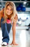 Gym woman in racing position Royalty Free Stock Images
