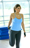 Gym woman - stretch Stock Images
