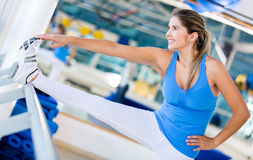 Gym woman stretching her leg Royalty Free Stock Photography