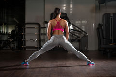 Gym Woman Stretching Legs Stock Photography