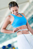 Gym woman taking measurements Royalty Free Stock Photos
