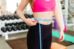 Gym woman taking measurements with a tape measure Stock Photography