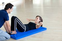 Gym woman with trainer Royalty Free Stock Image