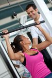 Gym woman and trainer Stock Photo
