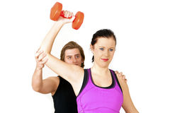 Gym woman with trainer Stock Photography