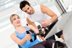 Gym woman with trainer Royalty Free Stock Photos