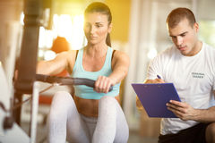 Gym woman and trainer Royalty Free Stock Image