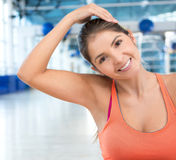 Gym woman warming up Stock Images