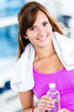 Gym woman with water bottle Stock Image