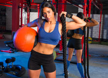 Gym woman with weighted ball and rope Royalty Free Stock Photos