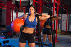 Gym woman with weighted ball and rope Stock Image