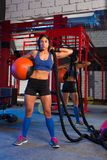 Gym woman with weighted ball and rope Royalty Free Stock Image