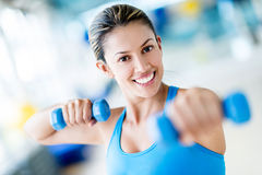 Gym woman weightlifting Royalty Free Stock Image