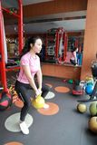 Gym woman in gym working out using kettlebells indoor. Beautiful, press. royalty free stock photography