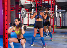 Gym women with barbell and hex dumbbell Stock Image