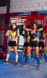 Gym women with barbell and kettlebell workout Stock Photo