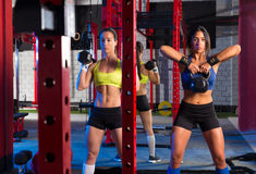 Gym women with barbell and kettlebell workout Royalty Free Stock Photos