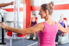 Gym women doing strength or fitness training. Happy, young women doing strength or sports training in gym for a better fitness Stock Photo