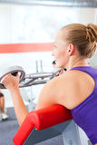Gym women doing strength or fitness training. Happy, young woman doing strength or sports training in gym for a better fitness Royalty Free Stock Photo