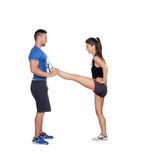 Gym women exercising with her personal trainer Stock Photo