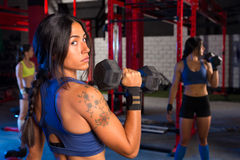 Gym women with hex barbell workout Stock Photo