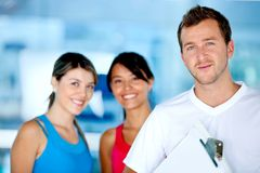 Gym women with their trainer Royalty Free Stock Image