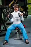 Gym workout. Attractive very fit young man working out in a gym Royalty Free Stock Photography