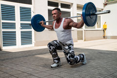 Gym Workout with Barbell Lunge Stock Photo