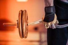 Gym Workout Closeup. Photo. Caucasian Men Lifting Weight in the Home Gym royalty free stock photos