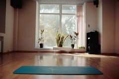 Gym with yoga mat. Interior Royalty Free Stock Photos