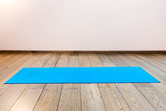 Gym with yoga mat. Interior Stock Photo