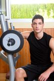 Gym young man posing bodybuilding weigths Royalty Free Stock Image