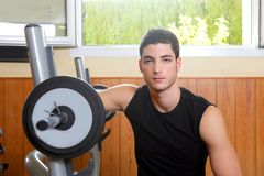 Gym young man posing bodybuilding weigths Stock Photo