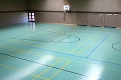 Gymnasium. A green floor in a gymnasium stock photography