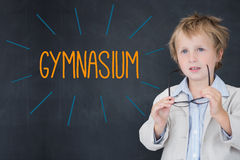 Gymnasium against schoolboy and blackboard Royalty Free Stock Photos